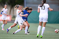Seattle, WA - Friday June 23, 2017: Becky Sauerbrunn and Katie Johnson during a regular season National Women's Soccer League  (NWSL) match between the Seattle Reign FC and FC Kansas City at Memorial Stadium.