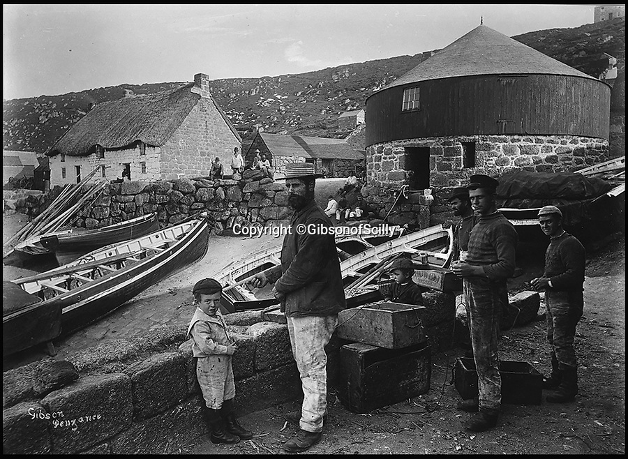 BNPS.co.uk (01202 558833)<br /> Pic: GibsonOfScilly/BNPS<br /> <br /> Locals in Sennen Cove around 1900.<br /> <br /> An archive of eye-opening photographs documenting the grim reality of Poldark's Cornwall has emerged for sale for &pound;25,000.<br /> <br /> More than 1,500 black and white images show the gritty lives lived by poverty-stricken families in late 19th and early 20th century Cornwall - around the same time that Winston Graham's famous Poldark novels were set.<br /> <br /> The collection reveals the lowly beginnings of towns like Rock, Fowey, Newquay and St Ives long before they became picture-postcard tourist hotspots.<br /> <br /> Images show young filth-covered children playing barefoot in squalid streets, impoverished families standing around outside the local tax office, and weather-beaten fishwives tending to the day's catch.<br /> <br /> The Cornish archive, comprising 1,200 original photographic prints and 300 glass negative plates, is tipped to fetch &pound;25,000 when it goes under the hammer as one lot at Penzance Auction House.