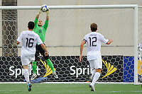 United States (USA) goalkeeper Luis Robles (18) makes a save. The United States and Haiti played to a 2-2 tie during a CONCACAF Gold Cup Group B group stage match at Gillette Stadium in Foxborough, MA, on July 11, 2009. .