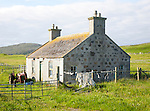 Croft house on Vatersay island, Barra, Outer Hebrides, Scotland, UK