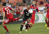 WASHINGTON, DC. - AUGUST 22, 2012:  Lionard Pajoy (26) of DC United pushes past  Arnie Friedrich (23) of the Chicago Fire during an MLS match at RFK Stadium, in Washington DC,  on August 22. United won 4-2.