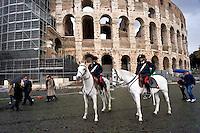 Roma 23 Novembre 2015<br /> Colosseo sorvegliato speciale in vista del Giubileo essendo un luogo di forte impatto turistico. Il piano, ideato dalla questura con la prefettura e forze dell&rsquo;ordine, prevede un potenziamento dei controlli antiterrorismo nella zona intorno al Colosseo. Carabinieri a cavallo durante i controlli antiterrorismo al Colosseo.<br /> Rome 23 November 2015<br /> Colosseum special surveillance in view of the Jubilee being a place of great tourist impact. The plan, devised by the police with the prefecture, provides for the reinforcement of anti-terrorism controls in the area around the Colosseum.  Carabinieri on horseback during the anti-terrorism controls the Colosseum