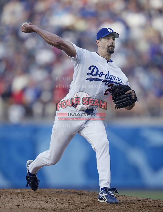 Kevin Brown of the Los Angeles Dodgers pitches during a 2002 MLB season game at Dodger Stadium, in Los Angeles, California. (Larry Goren/Four Seam Images)