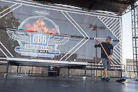 NWA Democrat-Gazette/J.T. WAMPLER Terry Curtis of Little Rock sweeps the main stage Sunday Sept. 27, 2015 at the Bikes Blues and BBQ Dickson Street venue. Next year's dates for the festival are Sept. 21-24, 2016.