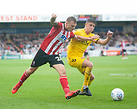 Lincoln City's Harry Anderson vies for possession with Fleetwood Town's Harrison Biggins<br /> <br /> Photographer Andrew Vaughan/CameraSport<br /> <br /> The EFL Sky Bet League One - Lincoln City v Fleetwood Town - Saturday 31st August 2019 - Sincil Bank - Lincoln<br /> <br /> World Copyright © 2019 CameraSport. All rights reserved. 43 Linden Ave. Countesthorpe. Leicester. England. LE8 5PG - Tel: +44 (0) 116 277 4147 - admin@camerasport.com - www.camerasport.com