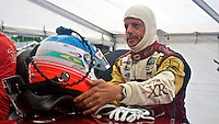 Oswaldo Negri reaches for his helmet before practice, Road America, Elkhart Lake, Wisconsin.  (Photo by Brian Cleary/www.bcpix.com)