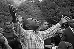 Ecstatic evangelical Christian preacher with raised arms and his congregation praising God at Speaker's Corner