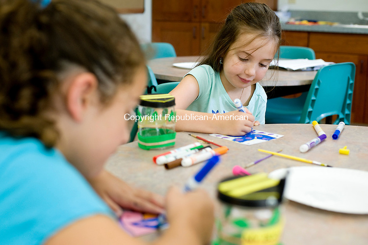 MIDDLEBURY, CT-080817JS01-- Gianna DeLorenzo,7, of Middlebury, left, along with Charis (CQ) Hubbard, 7, of Waterbury, decorate their pinwheels during the summer reading camp craft program Tuesday at the Middlebury Public Library. <br /> Jim Shannon Republican-American
