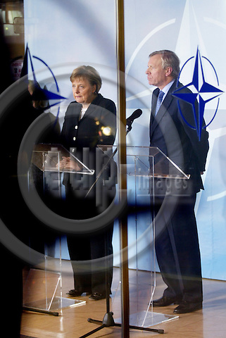 BRUSSELS - BELGIUM - 23 NOVEMBER 2005 -- Angela MERKEL, Germany's new Chancellor, left, and NATO Secretary General Jaap de HOOP SCHEFFER, during a press conference in connection with her first visit to NATO.  PHOTO: ERIK LUNTANG / EUP-IMAGES..