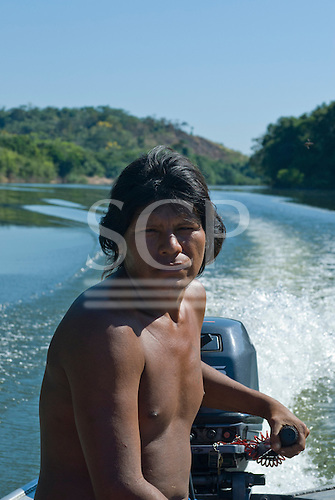 Pará State, Brazil. Rio Fresco river. Boatman Nopokaí Kayapó at the helm between Kikretum and Moikarako.