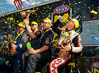 Jul 21, 2019; Morrison, CO, USA; NHRA drivers (from left) Tommy Johnson Jr, Andrew Hines, Greg Anderson and Steve Torrence celebrate after winning the Mile High Nationals at Bandimere Speedway. Mandatory Credit: Mark J. Rebilas-USA TODAY Sports
