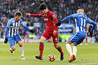 Ki Sung-Yueng of Swansea City (C) gets past Pascal Gross (L) and Anthony Knockaert of Brighton (R) during the Premier League match between Brighton and Hove Albion and Swansea City and at the Amex Stadium, Brighton, England, UK. Saturday 24 February 2018