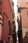 Narrow gap between apartment buildings in city centre of Seville, Spain