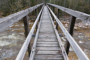 Decking of the 180-foot-long suspension bridge along the Wilderness Trail in the Pemigewasset Wilderness, New Hampshire. It spanned the East Branch of the Pemigewasset River just above the East Branch & Lincoln Railroad's old trestle No. 17. Built in 1959-1960, the footbridge was dismantled in 2009 because of safety issues.