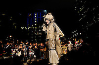 An oversized performer entertains New Year's Eve revelers during First Night Charlotte 2010. The family-friendly public event (no alcohol allowed) is an annual cultural New Year's Eve celebration held in downtown / uptown / Charlotte center city. Charlotte First Night - An Imagination Celebration brought together artists, musicians, dancers and more from across the country. The New Year's event is organized by Charlotte Center City Partners, which facilitates and promotes the economic and cultural development of this North Carolina urban core.