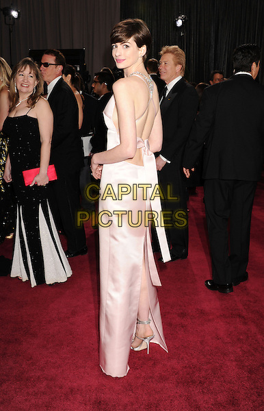 Anne Hathaway (wearing Prada).85th Annual Academy Awards held at the Dolby Theatre at Hollywood & Highland Center, Hollywood, California, USA..February 24th, 2013.oscars full length pink sleeveless silk satin dress backless straps jewel encrusted embellished back behind rear looking over shoulder slit split .CAP/ROT/TM.©Tony Michaels/Roth Stock/Capital Pictures