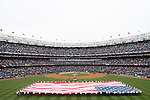 Yankee Stadium,<br /> APRIL 7, 2014 - MLB :<br /> A general view. A giant American flag is unfurled as New York Yankees and Baltimore Orioles players line up during pre-game ceremonies for the Yankees home opener at Yankee Stadium in Bronx, New York, United States. (Photo by Thomas Anderson/AFLO) (JAPANESE NEWSPAPER OUT)