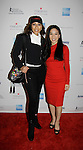As The World Turns Tamara Tunie (Honoree Chair) poses with Michelle Kwan at Skating with the Stars - a benefit gala for Figure Skating in Harlem in its 17th year is celebrated with many US, World and Olympic Skaters honoring Michelle Kwan and Jeff Treedy on April 7, 2014 at Trump Rink, Central Park, New York City, New York. (Photo by Sue Coflin/Max Photos)