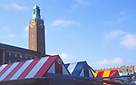 AYBR9A Colourful market stalls and city hall clock Norwich England