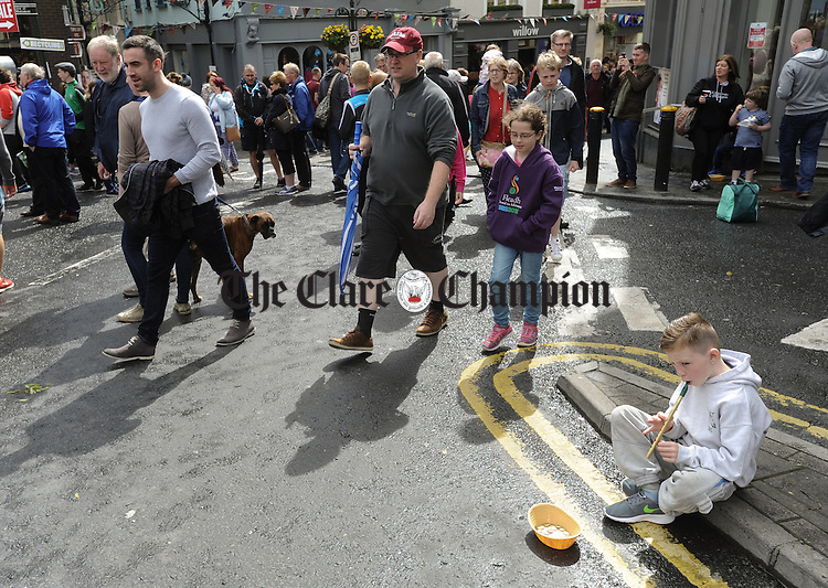Local lad Patrick Sherlock, aged 7, playing on the street, during Fleadh Cheoil na hEireann in Ennis. Photograph by John Kelly.