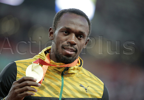 28.08.2015. Birds Nest Stadium, Beijing, China.  Usain Bolt of Jamaica poses with his gold medal on the podium during the medal ceremony of the men's 200m final at the Beijing 2015 IAAF World Championships at the National Stadium, also known as Bird's Nest, in Beijing, China, 28 August 2015.