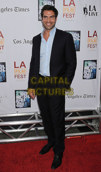 "Jordi Vilasuso.2011 Los Angeles Film Festival Premiere of ""Don't Be Afraid of the Dark"" held at Regal Cinemas L.A. Live, Los Angeles, California, USA..June 26th, 2011.full length black suit blue shirt.CAP/ROT/TM.©Tony Michaels/Roth Stock/Capital Pictures"