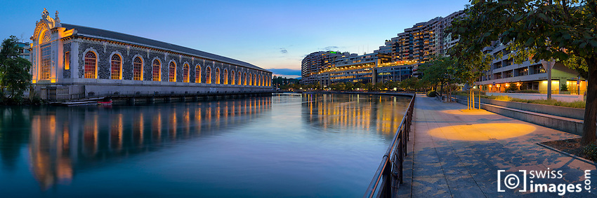 """Panorama view of the """"Quai du Seujet"""" with the """"Bâtiment des Forces Motrices"""" at dusk"""