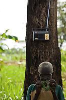 A woman and a radio in Nyori South Sudan.