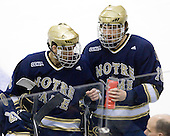 Shayne Taker (Notre Dame - 3), Stephen Johns (Notre Dame - 28) - The University of Notre Dame Fighting Irish defeated the Merrimack College Warriors 4-3 in overtime in their NCAA Northeast Regional Semi-Final on Saturday, March 26, 2011, at Verizon Wireless Arena in Manchester, New Hampshire.