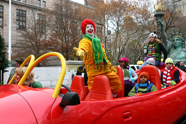 ATMOSPHERE.The 84th Annual Macy's Thanksgiving Day Parade on November 25, 2010 in New York City, NY, USA..November 25th, 2010.gv general view ronald mcdonald mcdonalds clown yellow red wig green scarf gloves .CAP/ADM/PZ.©Paul Zimmerman/AdMedia/Capital Pictures.