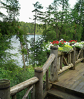 View across the lake in the Adirondack mountains from the log cabin's porch