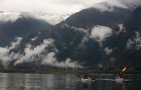Jennifer Johnston, left, of Bothell, Wash., and Judy Robb of Bothell, Wash., paddle across Baker Lake underneath slopes dusted with fresh snow near Concret, Wash., Saturday Sept. 29, 2007.