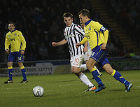 Paul McGowan tracks James Fowler in the St Mirren v Kilmarnock Clydesdale Bank Scottish Premier League match played at St Mirren Park, Paisley on 2.1.13.