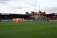 The teams have 1 minute applause before the Sky Bet League 2 match between AFC Wimbledon and Wycombe Wanderers at the Cherry Red Records Stadium, Kingston, England on 21 November 2015. Photo by Alan  Stanford/PRiME.