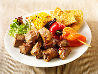 BBQ beef kebabs and sweet corn, peppers & red onions. Funky Stock Photos images.