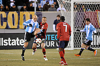 Esteban Cambiasso (5) of Argentina under pressure from Jay DeMerit (15) of the United States. The United States (USA) and Argentina (ARG) played to a 1-1 tie during an international friendly at the New Meadowlands Stadium in East Rutherford, NJ, on March 26, 2011.