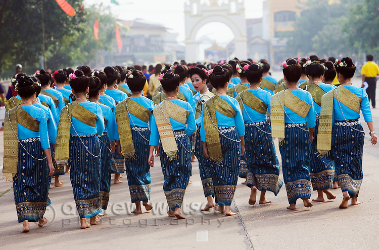 Dancers in ceremonial Isan dress arrive at Wat Phra That Phanom during the festival of Ok Phansa.  That Phanom, Nakhon Phanom province, THAILAND.