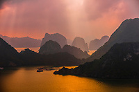 High angle view of Halong Bay from Ti Top Island, North Vietnam. The bay features 3,000  limestone and dolomite karsts and islets in various shapes and sizes sprinkled over 1,500 square kilometers. It offers a wonderland of karst topography. It is a UNESCO World Heritage Site.