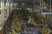 The robotics production line at the new 1.4 Billion dollar Nissan North America plant in Canton,MS is seen in action Tuesday November 18,2003. The robots preform a variety of specialized welds to each vehicle at the plant in rapid succession to a mix of vehicles at the same time.(Photo/Suzi Altman)