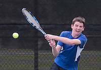 NWA Democrat-Gazette/J.T. WAMPLER Rogers High School's Payne Henry returns a volley Wednesday Oct. 5, 2016 at the 7A-West Tennis Tournament in Bentonville.