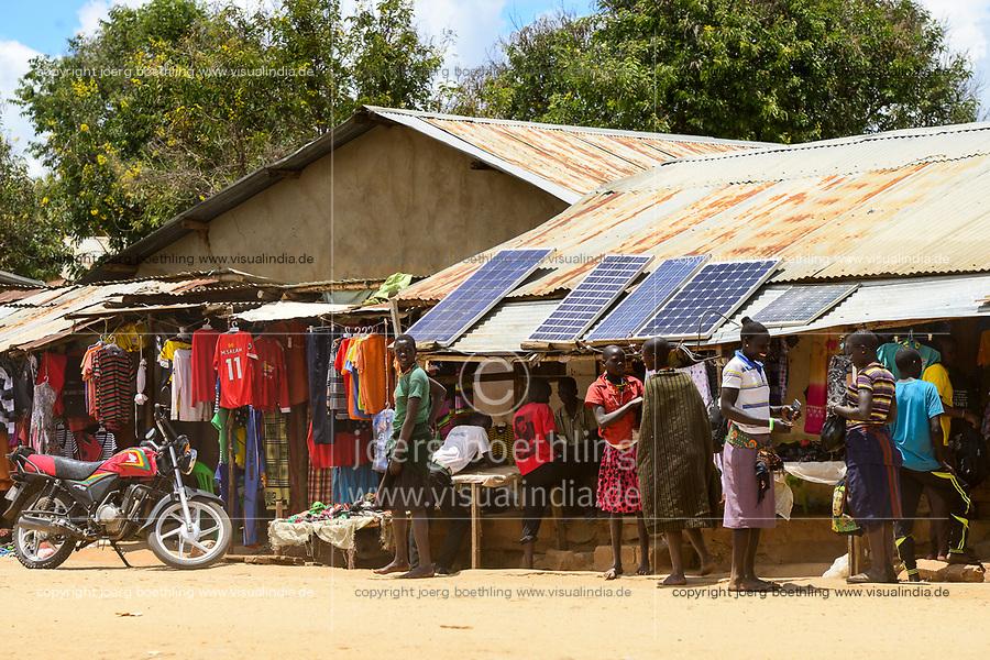 UGANDA, Karamoja, Kaabong, Karamojong pastoral tribe, shop with solar panels