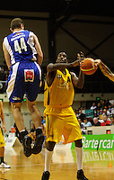 Saints guard Lindsay Tait (right) dispossesses Demarshay Johnson during the National basketball league match between the Wellington Saints  and Taranaki Mountainairs at TSB Bank Arena, Wellington, New Zealand onFriday, 9 April 2010. Photo: Dave Lintott / lintottphoto.co.nz
