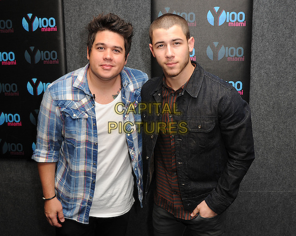 FORT LAUDERDALE, FL - JUNE 27: Nick Jonas visits Radio Station Y-100 on June 27, 2016 in Fort Lauderdale, Florida. <br /> CAP/MPI04<br /> &copy;MPI04/Capital Pictures