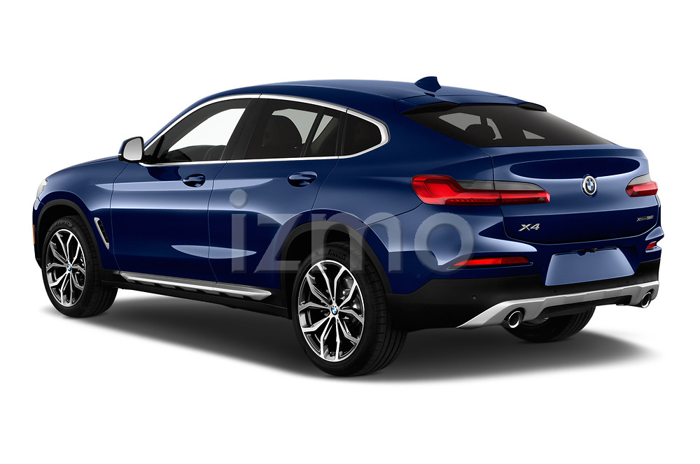 Car pictures of rear three quarter view of a 2020 BMW X4 xDrive30i 5 Door SUV angular rear