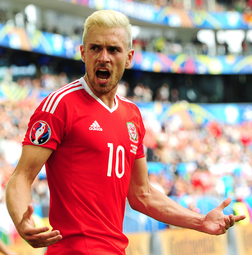 Wales's Aaron Ramsey pumps up the crowd after Hal Robson-Kanu puts his side 2-1 up<br /> <br /> Photographer Kevin Barnes/CameraSport<br /> <br /> International Football - 2016 UEFA European Championship - Group B - Wales v Slovakia - Saturday 11th June 2016 - Nouveau Stade de Bordeaux, Bordeaux<br /> <br /> World Copyright &copy; 2016 CameraSport. All rights reserved. 43 Linden Ave. Countesthorpe. Leicester. England. LE8 5PG - Tel: +44 (0) 116 277 4147 - admin@camerasport.com - www.camerasport.com