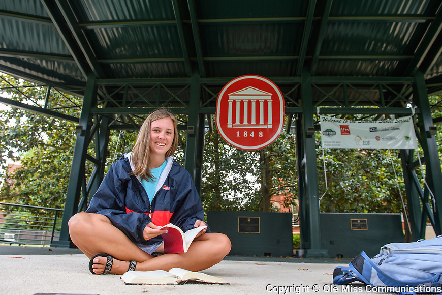 Ashlynn Landry takes a break from studying on the Grove stage to smile for the camera. Photo by Robert Jordan/Ole Miss Communications