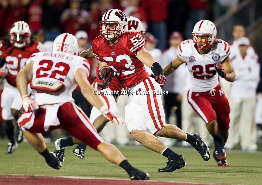 Wisconsin Badgers linebacker Mike Taylor (53) returns an interception during an NCAA Big Ten Conference college football game against the Nebraska Cornhuskers on October 1, 2011 in Madison, Wisconsin. The Badgers won 48-17. (Photo by David Stluka)