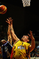 Lindsay Tait steals the ball off Ray Cameron under the basket during game two of the NBL Final basketball match between the Wellington Saints and Waikato Pistons at TSB Bank Arena, Wellington, New Zealand on Friday 20 June 2008. Photo: Dave Lintott / lintottphoto.co.nz