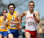 SIOUX FALLS, SD - MAY 3:  Dan Pettit from South Dakota State University strives to catch Stephen Nelson from the University of South Dakota as he glances back during the 1500 Meter Run Saturday at the 2014 Howard Wood Dakota Relays. (Photo by Dave Eggen/Inertia)