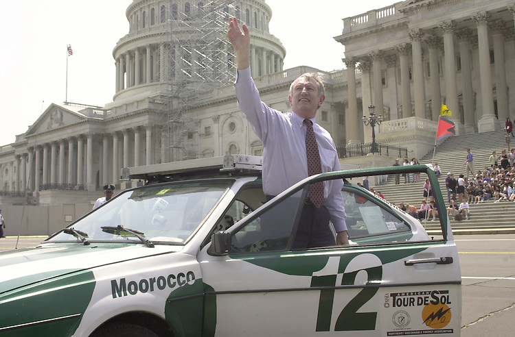car.3(TW)051800--Sens. Jeffords waves to the crowd after test driving a solar powered car made by members of the Vermont Technical College.